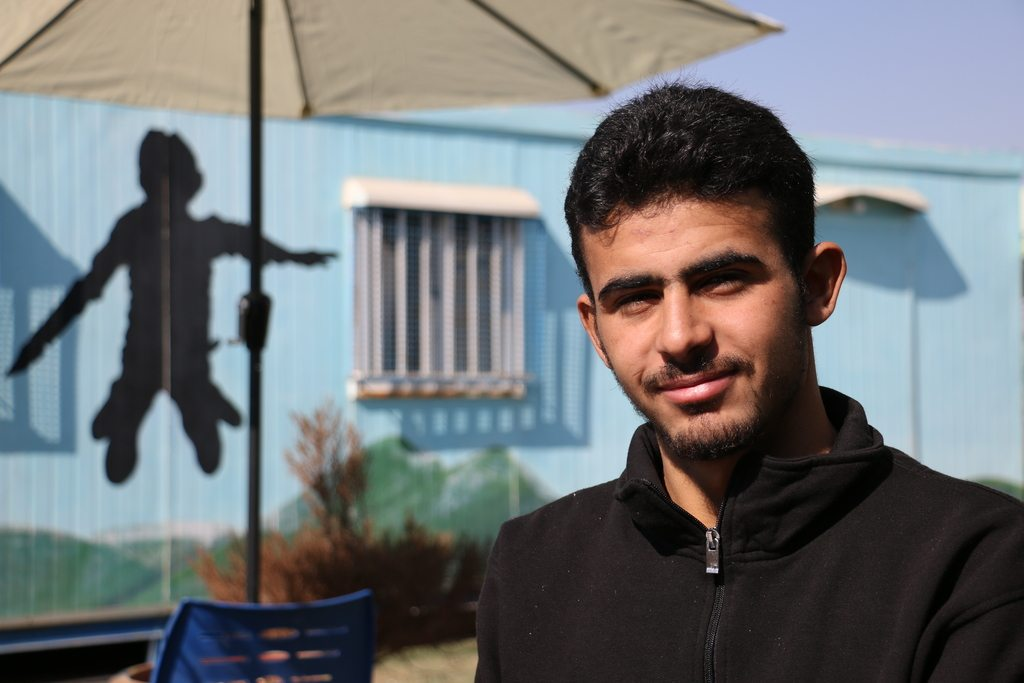 Tahir, a Syrian refugee who has been taking part in sewing classes funded by All We Can.