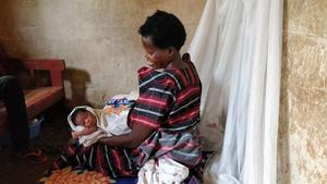 Kwagala, from Uganda, with her new born baby