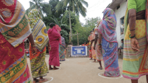 Women queue for sanitary kits in India