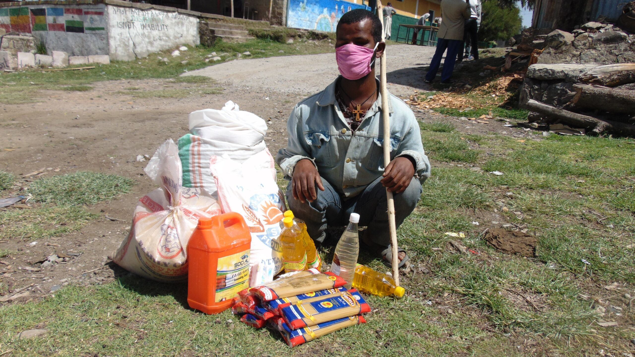 Biruk, a disabled student in Ethiopia, receives emergency food supplies.
