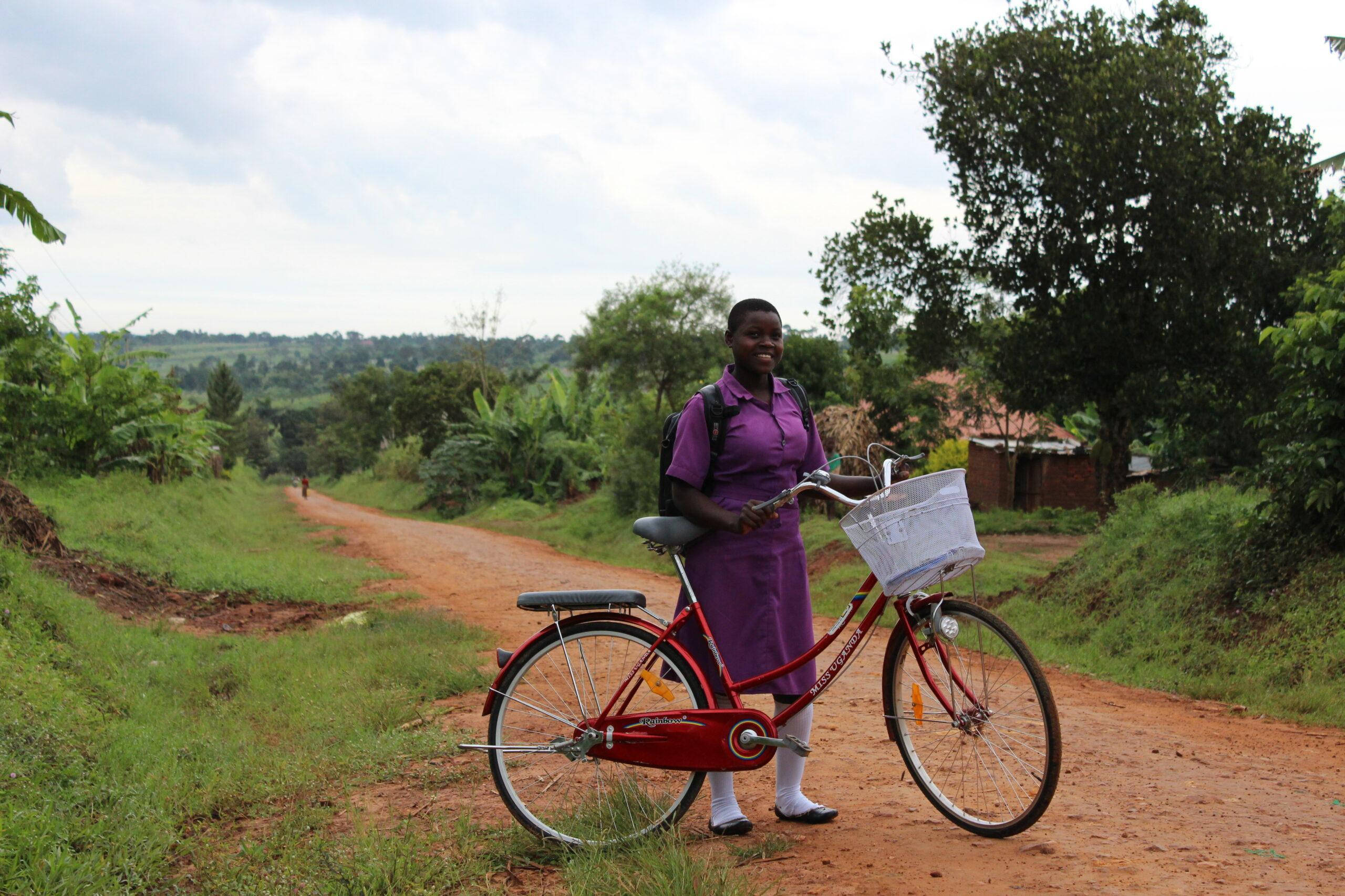 Nawalat with her bicycle in Uganda