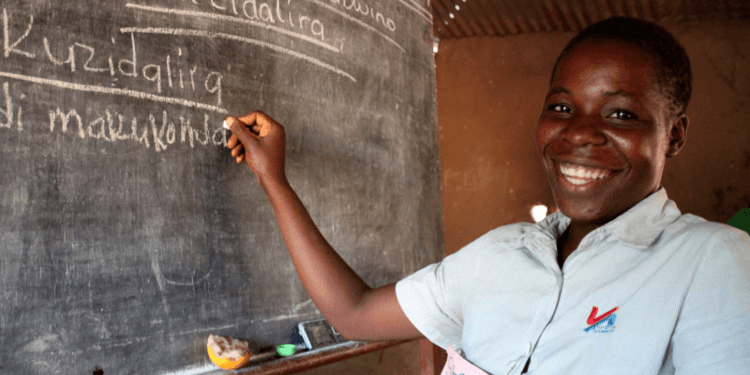 Sitera stands in her classroom in Malawi