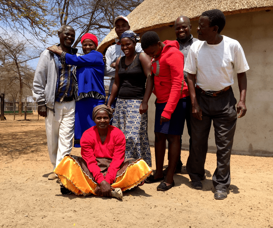 HEFO Project Committee Members gathered outside a home in Zimbabwe.