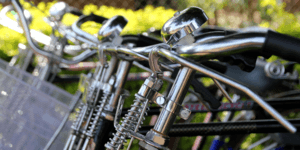 Close up of bicycle handlebars side by side.